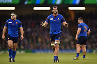 Yoann Maestri of France calms his team-mates down during a break in play. Rugby World Cup Pool D match between France and Ireland on October 11, 2015 at the Millennium Stadium in Cardiff, Wales. Photo by: Patrick Khachfe / Onside Images