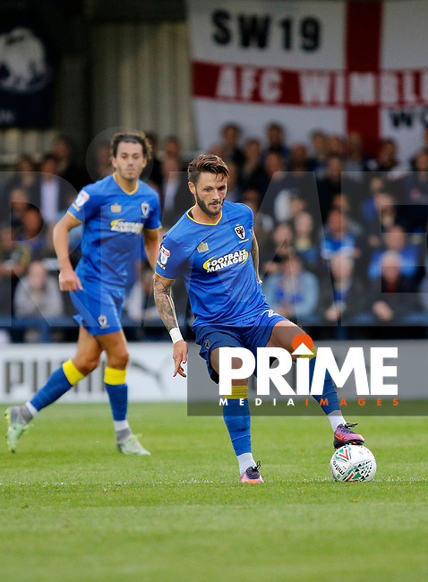 AFC Wimbledon's Callum Kennedy in action during the Carabao Cup match between AFC Wimbledon and Brentford at the Cherry Red Records Stadium, Kingston, England on 8 August 2017. Photo by Carlton Myrie.