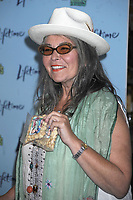***FILE PHOTO*** ABC CANCELS ROSEANNE AFTER RACIST TWEET<br /> Roseanne Barr hands out nuts at Chelsea Market to promote her new show 'Roseanne's Nuts'  premiering on the Lifetime network on July 13, 2011 in New York City. <br /> CAP/MPI01<br /> &copy;MPI01/Capital Pictures