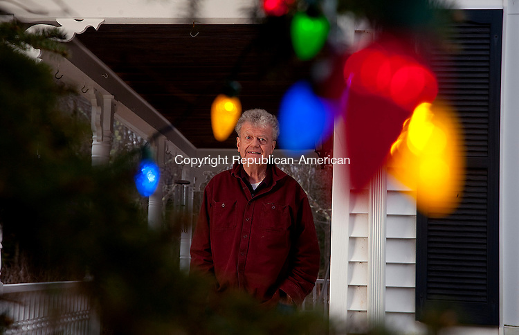WINSTED, CT-122213JS03-Patrick &quot;P.J. Shelley of Winchester Center, stands near his 60-foot high spruce at his home on Sunday. Shelley has 1250 lights put on the tree in tribute to his late wife, Lois who passed away in January. <br /> Jim Shannon Republican-American