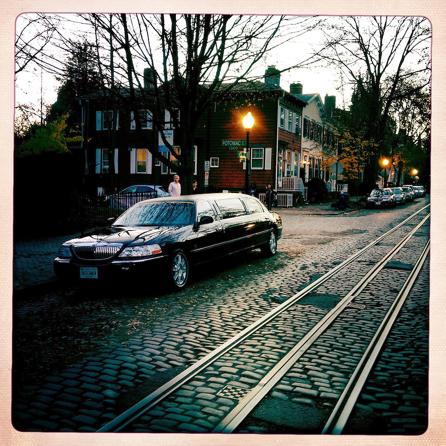 A limousine on a cobblestone street in the Georgetown neighborhood, situated along the Potomac River waterfront. Georgetown is one of the most affluent neighborhoods in Washington and home to many of the city's politicians and lobbyists, and lawyers.