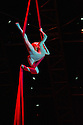 London, UK. 04.01.2014. Cirque du Soleil present QUIDAM at the Royal Albert Hall. Picture shows: Julie Cameron on Aerial SIlks. © Jane Hobson.