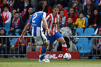 02.05.2012 SPAIN -  La Liga matchday 20th  match played between Atletico de Madrid vs Real Sociedadl (1-1) at Vicente Calderon stadium. The picture show Carlos Martinez Diez (Defender Real Sociedad) and Filipe Luis Karsmirski (Brazilian defender of At. Madrid)