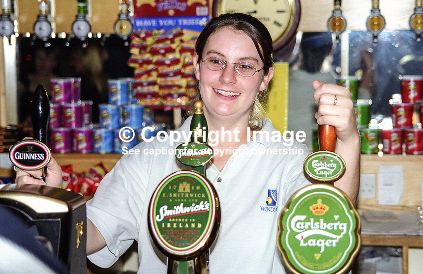 June McClintock, Raphoe, Co Donegal, Rep of Ireland, working in bar at Windsor Lawn Tennis Club, Belfast, N Ireland. October 1999. 199910115.<br />