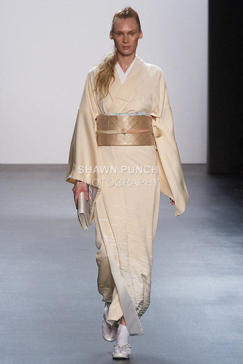 """Model walks runway in a """"Flow"""" silk kimono from the Hiromi Asai Fall Winter 2016 """"Spirit of the Earth"""" collection by Hiromi Asai & Kimono Artisan Kyoto, presented at NYFW: The Shows Fall 2016, during New York Fashion Week Fall 2016."""