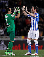 Real Sociedad's Claudio Bravo (l) and Mikel Gonzalez celebrate the victory after La Liga match.January 19,2013. (ALTERPHOTOS/Acero) /NortePhoto