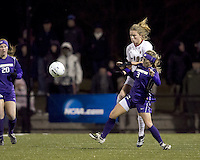 "Boston College forward Kristen Mewis (19) and University of Washington defender Hannah Greig (3) battle. In overtime, Boston College defeated University of Washington, 1-0, in NCAA tournament ""Elite 8"" match at Newton Soccer Field, Newton, MA, on November 27, 2010."