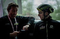 as it is a rainy stage 5 start; Simon Yates (GBR/Mitchelton-Scott) stays in the dryness of the teambus for as long as possible before the actual race start > DS Matt White checking the latest weather reports for what promises to be a SUPER wet stage indeed....<br /> <br /> Stage 5: Frascati to Terracina (140km)<br /> 102nd Giro d'Italia 2019<br /> <br /> ©kramon