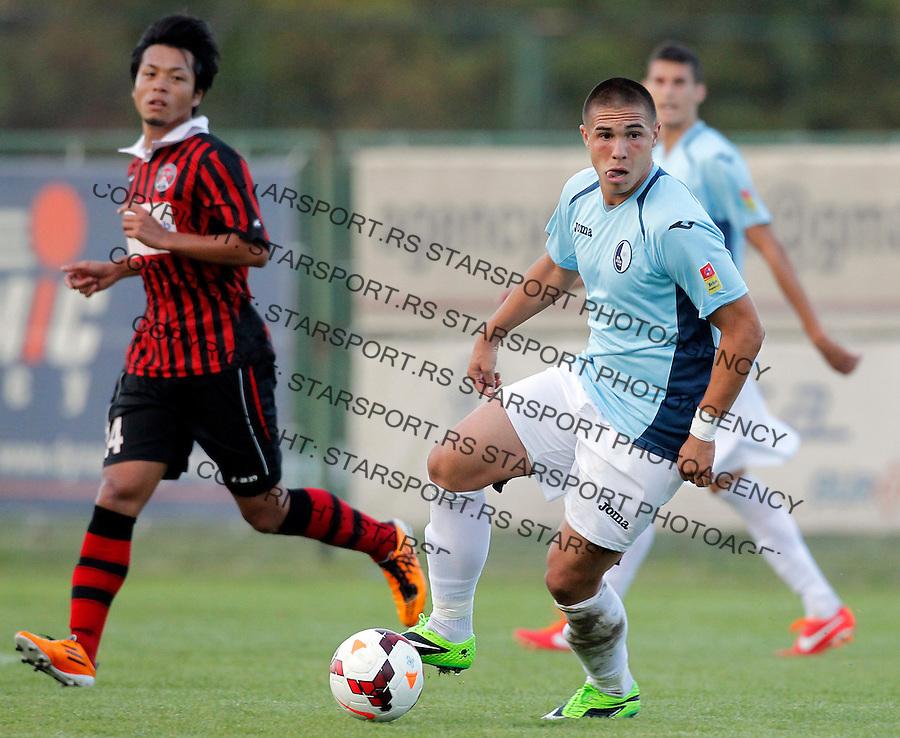 Fudbal Super liga season 2013-2014<br /> Rad v Sloboda Uzice<br /> Uros Djurdjevic and Okuno Shohei (L)<br /> Beograd, 21.09.2013.<br /> foto: Srdjan Stevanovic/Starsportphoto &copy;