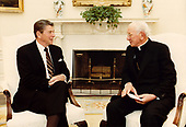 United States President Ronald Reagan, left, meets Cardinal John Krol, the Archbishop of Philadelphia, right, in the Oval Office of the White House in Washington, DC on May 11, 1983.<br /> Mandatory Credit: Bill Fitz-Patrick - White House via CNP