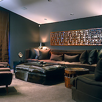 The recessed ceilng lights, dark green and browns and massive proportions of the furniture have resulted in a subtly masculine feel to this living room