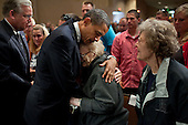 President Barack Obama consoles a woman at the Joplin Community Memorial Service at Missouri Southern University in Joplin, Mo., May 29, 2011. The President delivered remarks during the service for those impacted by the deadly tornado that struck Joplin on May 22, 2011. .Mandatory Credit: Pete Souza - White House via CNP