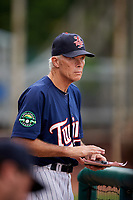Elizabethton Twins manager Ray Smith (2) in the dugout during a game against the Bristol Pirates on July 29, 2018 at Joe O'Brien Field in Elizabethton, Tennessee.  Bristol defeated Elizabethton 7-4.  (Mike Janes/Four Seam Images)
