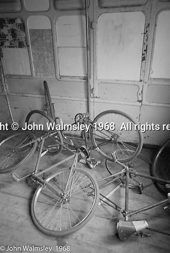 "Bikes in the ""Carriages"", Summerhill school, Leiston, Suffolk, UK. 1968.  These were two old railway carriages with compartments, used as kids' own rooms."