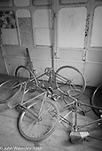 """Bikes in the """"Carriages"""", Summerhill school, Leiston, Suffolk, UK. 1968.  These were two old railway carriages with compartments, used as kids' own rooms."""