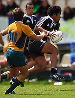 Julian Savea leaps past James Ambrosini during the International rugby match between New Zealand Secondary Schools and Suncorp Australia Secondary Schools at Yarrows Stadium, New Plymouth, New Zealand on Friday, 10 October 2008. Photo: Dave Lintott / lintottphoto.co.nz