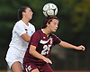 Bella DiBenedetto #25 of North Shore, right, heads a ball away from Katherine Galzerano #5 of Garden City during a Nassau County Class A varsity girls soccer quarterfinal at Garden City High School on Wednesday, Oct. 26, 2016. Garden City won by a score of 1-0.