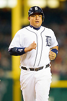 Miguel Cabrera (24) of the Detroit Tigers jogs down the third base line to score a run against the Tampa Bay Rays at Comerica Park on June 4, 2013 in Detroit, Michigan.  The Tigers defeated the Rays 10-1.  Brian Westerholt/Four Seam Images