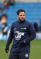 Sam Wood of Wycombe Wanderers warms up in his NHS Sign for Life shirt during the Sky Bet League 2 match between Wycombe Wanderers and Bristol Rovers at Adams Park, High Wycombe, England on 27 February 2016. Photo by Andy Rowland.