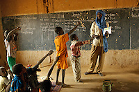 Abouleacrine ag Tadima teaches children basic health in his classroom in the village of Intedeyne. The challenge to educate children in Mali still exists and particularly for girls. Female literacy rates never reach even 50 percent of male literacy rates. Mali has the highest percentage of people living below the poverty line in any country in the world. Ninety percent of Malians survive on less than two dollars a day. /Felix Features