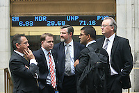 "NEW YORK CITY - September 16, 2008: A reflective mood is seen in group which emerged from the New York Stock Exchange  One trader said that ""volume is low and morale is low"".  Wall St.  Newsday/Ari Mintz  9/16/2008."