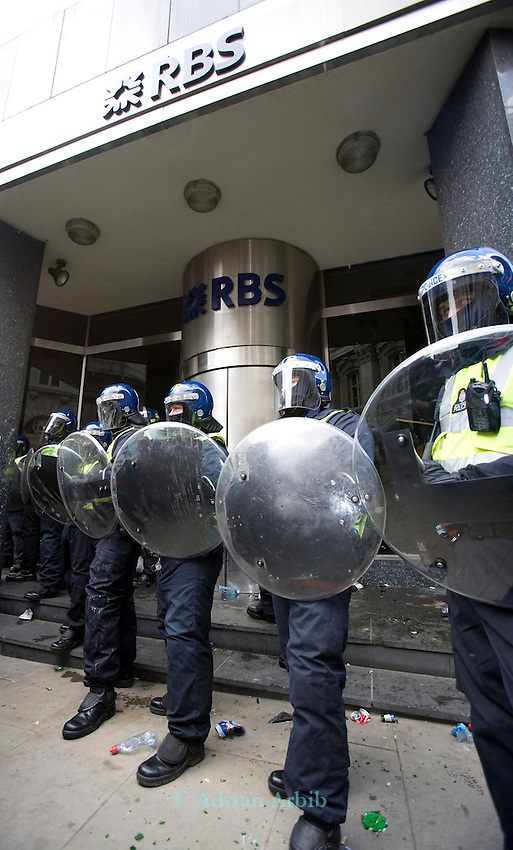 Riot police protect RBS bank in the city (next to the Bank of England). Thousands of protesters marched on the city of London during the G20 conference meeting  in London April 2009 , RBS  Bank windows were smashed on the ground floor. Police made around 90 arrests.