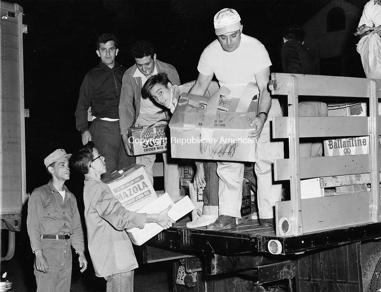 A warm-hearted neighborhood in New Haven sent this truck loaded with supplies to the families in the stricken area. Here, eager workers unload boxes and crates the CD headquarters on John St. A similar truck was sent to Naugatuck.