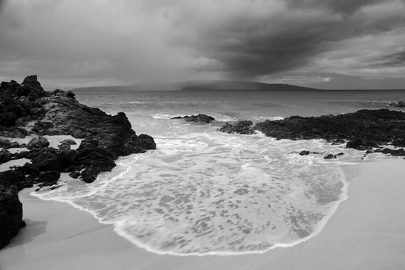 Storm with rain and beach off Maui, Hawaii.
