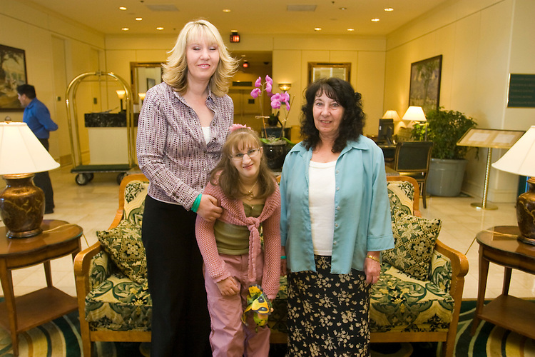 The Hughes family at the Share and Care Network's annual retreat held at the Doubletree Guest Suites Hotel in Boston on May 20, 2006. <br /> <br /> The Share and Care Network was created in 1981 by Pat Cahill when her son Scott was diagnosed with Cockayne Syndrome.  A rare form of dwarfism, Cockayne Syndrome is a genetically determined condition whose symptoms include microcephaly, mental retardation, progressive blindness, progressive hearing loss, premature aging, and a shortened lifespan averaging 18 years.  Those afflicted have distinctive facial features, including sunken eyes, pinched faces, and protruding jaws as well as distinctive gregarious, affectionate personalities.<br /> <br /> Because of the rarity of the condition (1/1,000 live births) and its late onset (characteristics usually begin to appear only after one year), many families and physicians are often baffled by children whose health begins to deteriorate after normal development.  It was partly with this in mind that the Share and Care Network was formed, to promote awareness of this disease as well as to provide a support network for those families affected.  In 1998 it began organizing an annual retreat, which has grown from three families in its inaugural year to more than 30 today.  Although the retreat takes place in the United States, families from as far as Japan arrive for this one weekend out of the year to share information and to support one another.