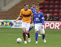Jamie Murphy closed down by Phil Neville in the Motherwell v Everton friendly match at Fir Park, Motherwell on 21.7.12 for Steven Hammell's Testimonial.