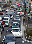 March 17, 2011, Tokorozawa, Japan - Motor vehicles line up for hours for gasoline at a local filling station in Tokorozawa, on the western suburb of Tokyo on Wednesday, March 16, 2011. Radiation fear prompted Tokyoites to panic buying of food and gasoline as a nuclear power plant, located along the Pacific coast northeast of Tokyo, has had a series of trouble in its reactors since a magnitude 9.0 earthquake hit northeastern Japan on March 11. (Photo by Natsuki Sakai/AFLO) [3615] -mis-