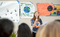 Lauren Breynaert '16 talks to students. Occidental College students march in a rally organized by Fossil Free Occidental on Nov. 14, 2014. The group hopes to end Oxy's reliance on fossil fuels by freezing all investments in the 200 largest fossil-fuel companies (measured by their proven carbon reserves in oil, gas or coal) and over the next five to ten years sell the stock in these same companies, and then reinvest 5%, at minimum, of the divested portfolio in socially responsible investments. (Photo by Marc Campos, Occidental College Photographer)