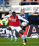 Nederland, Alkmaar, 25 november  2012.Eredivisie.Seizoen 2012-2013.AZ-Feyenoord.Jozy Altidore van AZ in duel om de bal met Joris Mathijsen van Feyenoord