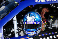 """Michael Waltrip (#40) shows off his """"Waltrip Brothers"""" helmet decorated with pics of brother Darrell after qualifying."""