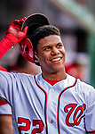 26 September 2018: Washington Nationals rookie outfielder Juan Soto returns to the dugout after scoring in the second inning against the Miami Marlins at Nationals Park in Washington, DC. The Nationals defeated the visiting Marlins 9-3, closing out Washington's 2018 home season. Mandatory Credit: Ed Wolfstein Photo *** RAW (NEF) Image File Available ***