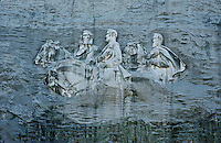 Bas-relief carving into the side of Stone Mountain of important confederate figures Stonewall Jackson, Robert E. Lee, Jefferson Davis. Georgia