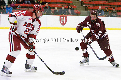 Matt McCollem (Harvard - 23), Nick Prockow (Colgate - 21) - The Harvard University Crimson defeated the visiting Colgate University Raiders 6-2 (2 EN) on Friday, January 28, 2011, at Bright Hockey Center in Cambridge, Massachusetts.