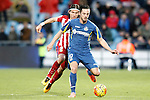 Getafe's Pablo Sarabia (r) and Atletico de Madrid's Filipe Luis during La Liga match. February 14,2016. (ALTERPHOTOS/Acero)