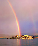 USA, California, Sierra Nevada Mountains. Rainbow over tufa formations on Mono Lake.