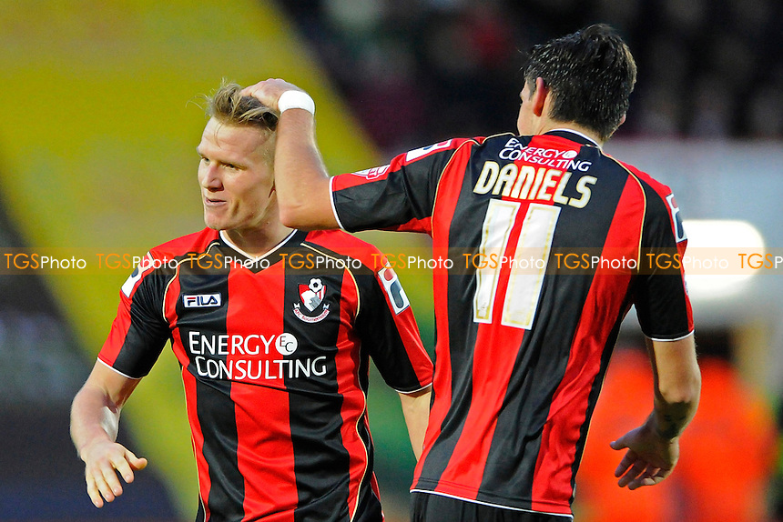 Matt Ritchie of AFC Bournemouth gets congratulated by Charlie Daniels of AFC Bournemouth - AFC Bournemouth vs Yeovil Town - Sky Bet Championship Football at the Goldsands Stadium, Bournemouth, Dorset - 26/12/13 - MANDATORY CREDIT: Denis Murphy/TGSPHOTO - Self billing applies where appropriate - 0845 094 6026 - contact@tgsphoto.co.uk - NO UNPAID USE
