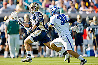 February 20, 2011:  Notre Dame midfield Steve Murphy (16) runs down field escaping Duke midfielder Terrence Molinari (32) during  Lacrosse action between the Duke Blue Devils and Notre Dame Fighting Irish during the Moe's Southwest SunShine Classic played at EverBank Field in Jacksonville, Florida. Notre Dame defeated Duke 12-7.
