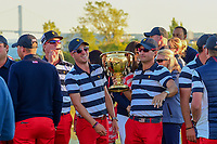 Justin Thomas (USA) and Kevin Kisner (USA) share a laugh with the Presidents Cup following round 4 Singles of the 2017 President's Cup, Liberty National Golf Club, Jersey City, New Jersey, USA. 10/1/2017. <br /> Picture: Golffile | Ken Murray<br /> <br /> All photo usage must carry mandatory copyright credit (&copy; Golffile | Ken Murray)