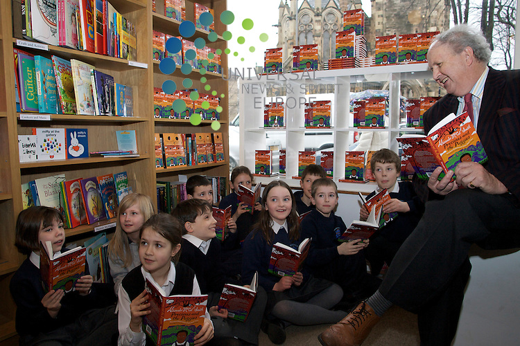 Scotland's Award winning Author Alexander McCall Smith has his book Precious and the Puggies translated in to Scots. .25/02/10...international bestselling author Alexander McCall Smith and Itchy Coo editor James Robertson today celebrated, along with a group of young readers from Bruntsfield Primary School, the publication of this unique book, a world first for the award winning Scots language imprint Itchy Co. .Precious and the Puggies by Alexander McCall Smith. Precious and the Puggies is an exciting, brand new story featuring Botswana's Precious Ramotswe. It has been specially written by Alexander McCall Smith for Itchy Coo and will be available only in Scots in its first year of publication. . .At The Fidra Childrens Bookshop, Edinburgh today...Picture by Mark Davison/ Universal News & Sport