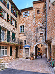 A passageway with arch among stone buildings in the Côte d'Azur village of Tourrettes sur Loup.