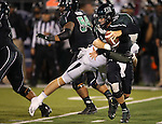Hawaii's Sean Schroeder (19) gets sacked by Nevada's Brock Hekking (53) during the second half of an NCAA college football game in Reno, Nev., on Saturday, Sept. 21, 2013. Nevada won 31-9. (AP Photo/Cathleen Allison)