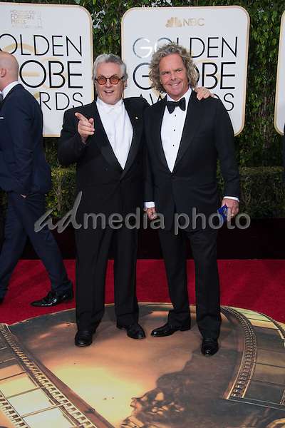 "George Miller and Doug Mitchell, Golden Globe nominees for BEST MOTION PICTURE – DRAMA, for their work on ""Mad Max: Fury Road,"" arrive at the 73rd Annual Golden Globe Awards at the Beverly Hilton in Beverly Hills, CA on Sunday, January 10, 2016. Photo Credit: HFPA/AdMedia"