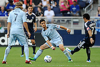 Camilo (8) Vancouver Whitecaps passes the ball pass Milos Stojcev (88) Sporting KC... Sporting KC defeated Vancouver Whitecaps 2-1 at LIVESTRONG Sporting Park, Kansas City, Kansas.