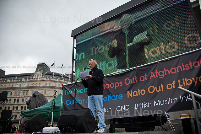 John Pilger (Australian journalist and documentary maker, based in London).<br /> <br /> London, 08/10/2011. Today Trafalgar Square was the stage of the &quot;Antiwar Mass Assembly&quot; organised by The Stop The War Coalition to mark the 10th Anniversary of the invasion of Afghanistan. Thousands of people gathered in the square to listen to speeches given by journalists, activists, politicians, trade union leaders, MPs, ex-soldiers, relatives and parents of soldiers and civilians killed during the conflict, and to see the performances of actors, musicians, writers, filmmakers and artists. The speakers, among others, included: Jeremy Corbin, Joe Glenton, Seumas Milne, Brian Eno, Sukri Sultan and Shadia Edwards-Dashti, Hetty Bower, Mark Cambell, Sanum Ghafoor, Andrew Murray, Lauren Booth, Kate Hudson, Sami Ramadani, Yvone Ridley, Mark Rylance, Dave Randall, Roger Lloyd-Pack, Rebecca Thorn, Sanasino al Yemen, Elvis McGonagall, Lowkey (Kareem Dennis), Tony Benn, John Hilary, Bruce Kent, John Pilger, Billy Hayes, Alison Louise Kennedy, Joan Humpheries, Jemima Khan, Julian Assange, Lindsey German, George Galloway. At the end of the speeches a group of protesters marched toward Downing Street where after a peaceful occupation the police made some arrests.