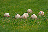 A bunch of baseballs sit on the field prior to the  Midwest League game between the Beloit Snappers and the Clinton LumberKings at Ashford University Field on June 12, 2016 in Clinton, Iowa.  The LumberKings won 1-0.  (Dennis Hubbard/Four Seam Images)