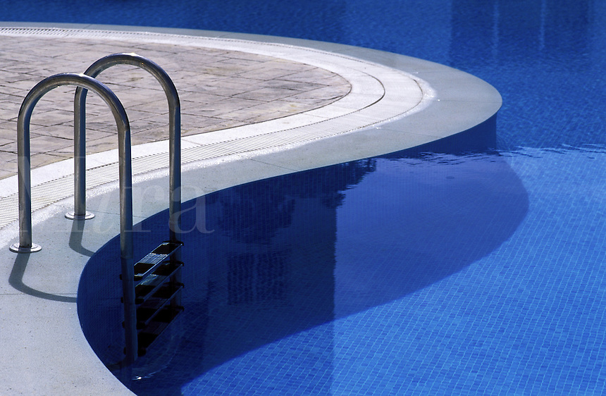 Steps into water of curved hotel swimming pool